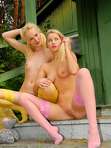 Blonde Lesbians Seductively Posing Outdoors