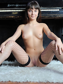 Sweet Girl in Fishnet Stockings Flaunting her Flawless Naked Body