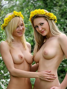 Petite Blonde Lesbians Posing Seductively With Flower Crowns