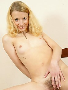 Hot Blonde Shows Her Unshaved Pussy on Chair with Complete Undress