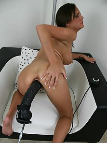 Nasty Brunette Babe Fucked Hard By a Monster Dildo